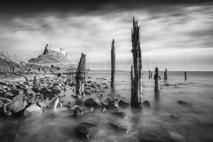 Lindisfarne Castle photographed in midday light using  a10-stop ND filter to extend the exposure time and blur the water movement