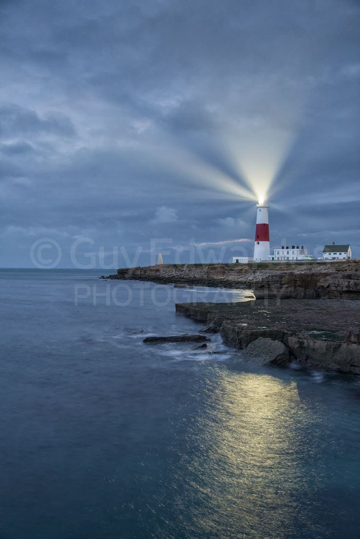 Portland Bill Lighthouse taken well before sunrise when the beams of the lighthouse are more prominent.