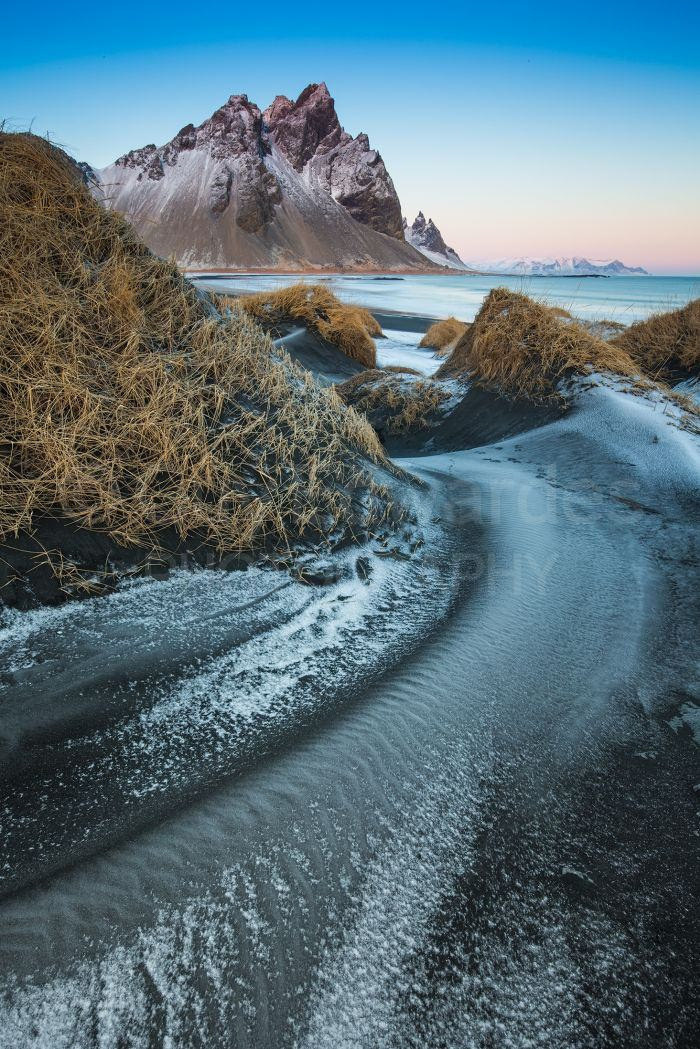 The patterns created by the wind blowing through the sand dunes looked like rivers of frost and snow.