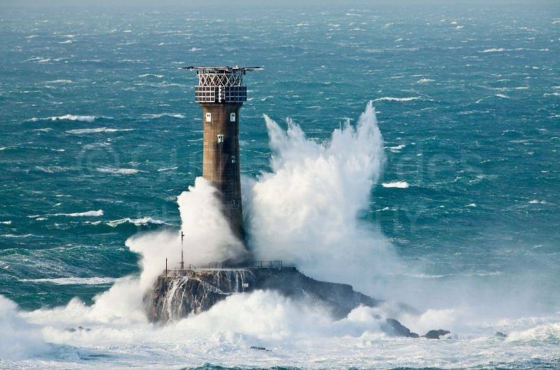 Waves crashing around Longships Lighthouse, Lands End ...